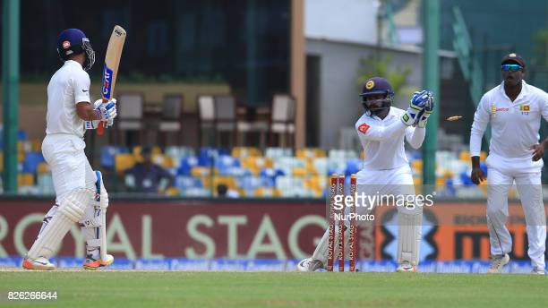 Sri Lankan wicket keeper Niroshan Dickwella removes the bails to dismiss Indian cricketer Ajinkya Rahane during the 2nd Day's play in the 2nd Test...