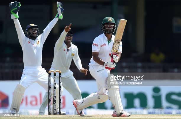 Sri Lankan wicketkeeper Niroshan Dickwella and fielder Asela Gunaratne unsuccessfully appeal for the wicket of Bangladesh batsman Tamim Iqbal during...
