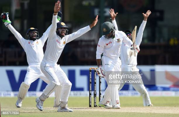 Sri Lankan wicketkeeper Niroshan Dickwella and fielder Kusal Mendis unsuccessfully appeal for the wicket of Bangladesh batsman Imrul Kayes during the...