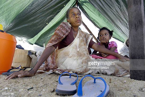 Sri Lankan woman Bintari Dul who lost her son in the 26 December tsunamis sits in a tent with her daughter in Hambantota 250 km south of Colombo 21...