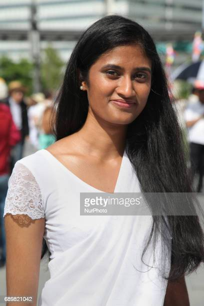 Sri Lankan woman dressed in a white sari during the festival of Vesak in Mississauga Ontario Canada on 28 May 2017 Vesak commonly known as Lord...