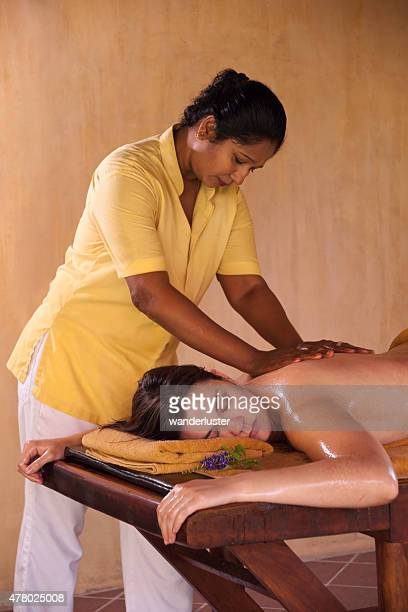 Sri Lankan woman giving an Ayurveda treatment
