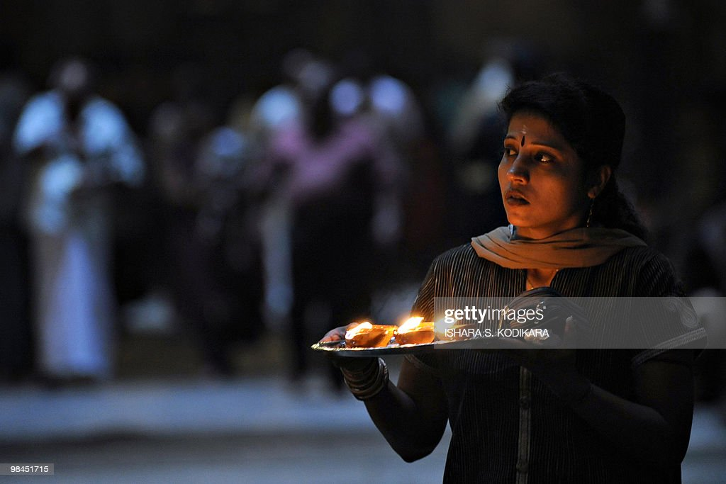 A Sri Lankan woman offers prayers at a Hindu Temple in celebration of the traditional Sinhala and Tamil New Year in Colombo on April 14 2010 The new...