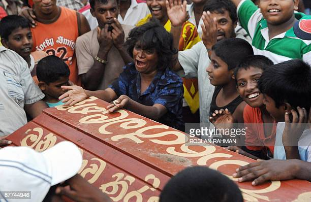 A Sri Lankan woman pretends to cry over a mock coffin of the Tamil Tiger leader Velupillai Prabhakaran to celebrate the country's military victory in...