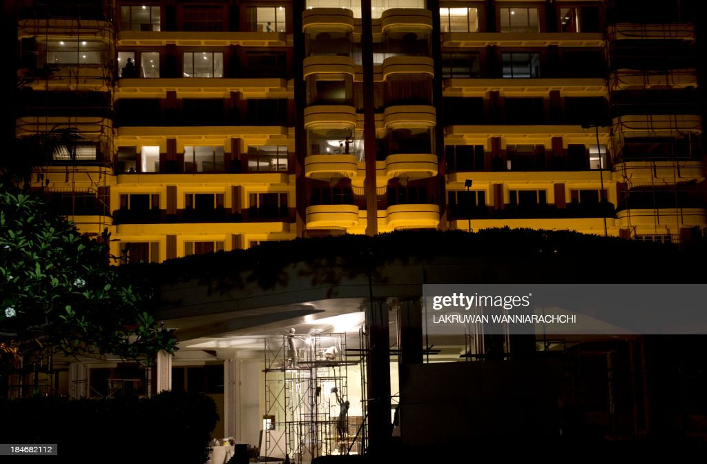 Sri Lankan workers refurbish a five-star hotel ahead of the Commonwealth Heads of Government Meeting (CHOGM) in Colombo on October 15, 2013. Sri Lanka is sprucing up the city ahead of the November 15-17 Commonwealth Heads of Government Meeting hosted by Sri Lanka.