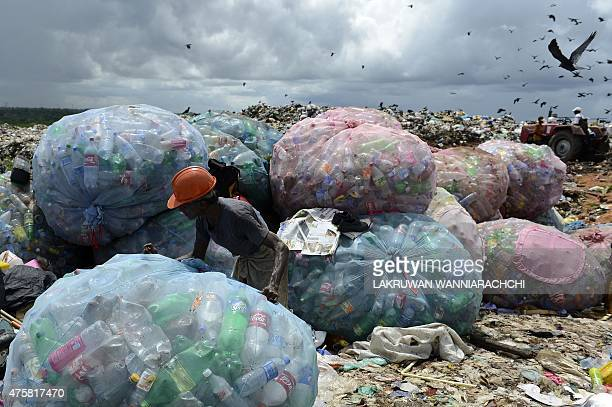 Sri Lankan workers sort garbage at Kathirana on the outskirts of Colombo on June 4 on the eve of World Environment Day Sri Lanka is stepping up...