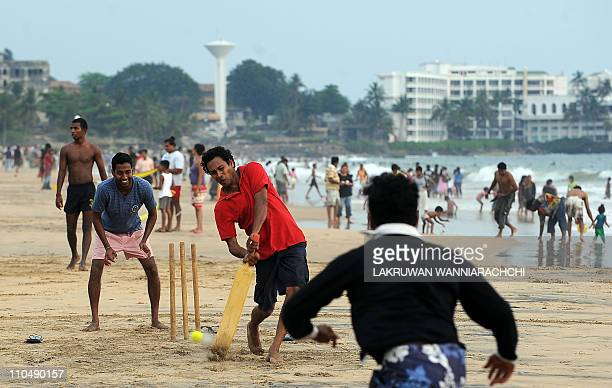 Sri Lankan youngsters play cricket on a beach in Colombo on March 20 2011 Sri Lanka cohosts the Cricket World Cup along with Bangladesh and India AFP...