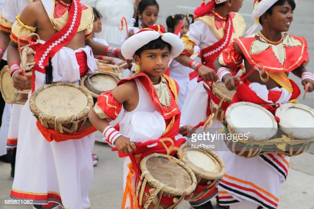 Sri Lankan youth play a rhythmic tune on traditional drums during a procession celebrating the festival of Vesak in Mississauga Ontario Canada on 28...