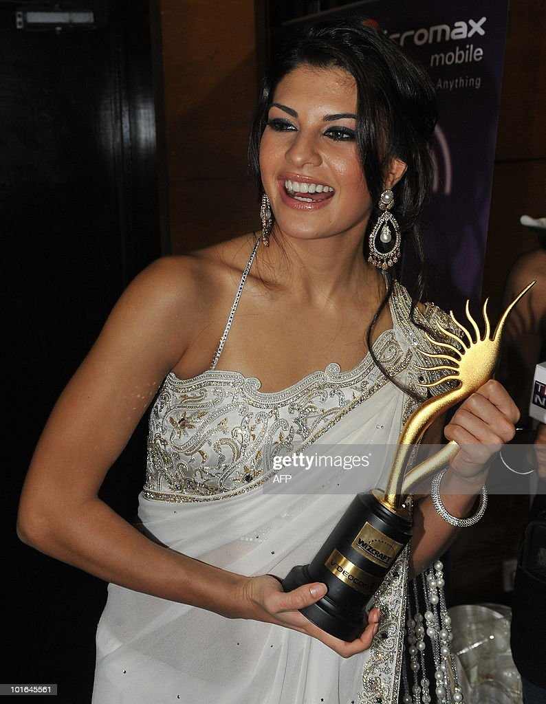 Sri Lankan-born Bollywood actress Jacqueline Fernandez poses with a trophy after receiving best debut female actress award at the International Indian Film Academy (IIFA) awards in Colombo on June 5, 2010. Bollywood actors arrived in Sri Lanka to attend the three-day International Indian Film Academy (IIFA) awards and surrounding events that begun in Colombo on June 3. AFP PHOTO/ Punit PARANJPE