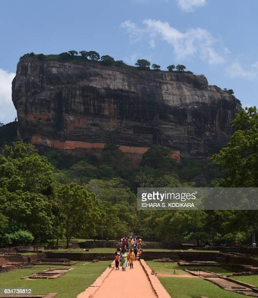 Sri Lankans and foreign tourists visit the 80metre fortress of Sigiriya rock in Sigiriya northcentral Sri Lanka on February 11 2017 The Sigiriya rock...