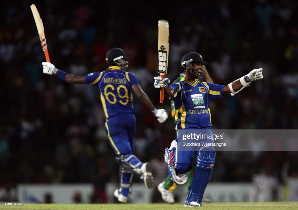 Sri Lankan's batsman <a gi-track='captionPersonalityLinkClicked' href=/galleries/search?phrase=Angelo+Mathews&family=editorial&specificpeople=5622021 ng-click='$event.stopPropagation()'>Angelo Mathews</a> (L) and <a gi-track='captionPersonalityLinkClicked' href=/galleries/search?phrase=Nuwan+Kulasekara&family=editorial&specificpeople=608308 ng-click='$event.stopPropagation()'>Nuwan Kulasekara</a> celebrate their victory against the Pakistan during the fifth one day international match between Sri Lanka and Pakistan at R. Premadasa Stadium on June 18, 2012 in Colombo, Sri Lanka.