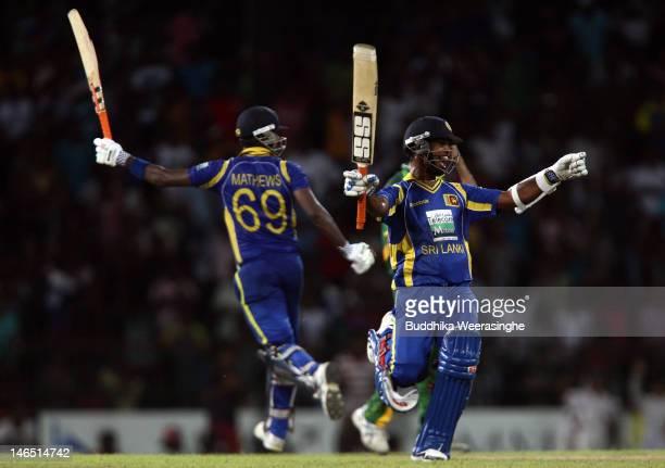 Sri Lankan's batsman Angelo Mathews and Nuwan Kulasekara celebrate their victory against the Pakistan during the fifth one day international match...