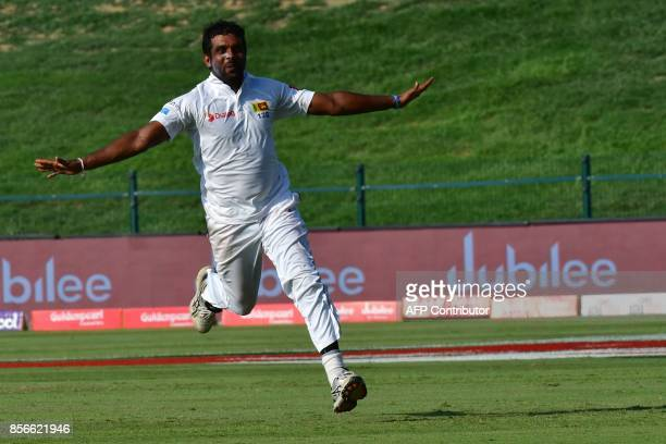 Sri Lankan's Dilruwan Perera celebrates after the victory on the fifth day of the first Test cricket match between Sri Lanka and Pakistan at Sheikh...