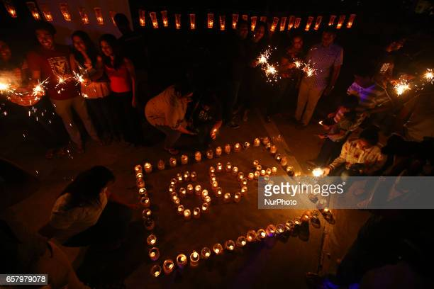 Sri Lankans light lamps to form the number 60 representing the 60 minutes of Earth Hour during Earth Hour in Colombo Sri Lanka March 25 2017