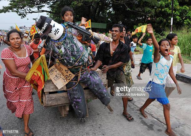Sri Lankans parade down the street with an effigy of Tamil Tiger leader Velupillai Prabhakaran to celebrate the country's military victory in Colombo...