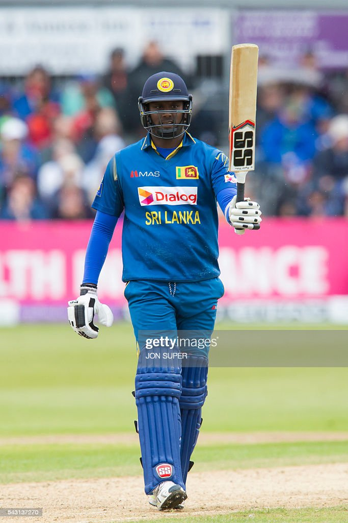 Sri Lanka's Angelo Mathews raises his bat as he reaches his 50 during play in the third one day international (ODI) cricket match between England and Sri Lanka at Bristol cricket ground in Bristol, south-west England, on June 26, 2016. England captain Eoin Morgan won the toss and elected to field against Sri Lanka in the third one-day international at Bristol on Sunday. / AFP / JON