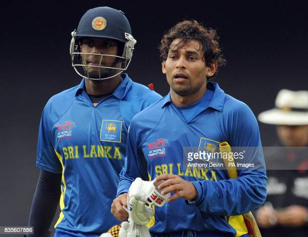 Sri Lanka's Angelo Matthews and Tillakaratne Dilshan leave the field after Dilshan scored 96 not out during the ICC World Twenty20 Semi Final at The...