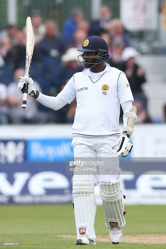 Sri Lanka's Angelo Matthews celebrates after scoring 50 on the third day of the second test cricket match between England and Sri Lanka at the Riverside in Chester Le Street, north east England on May 29, 2016. / AFP / SCOTT