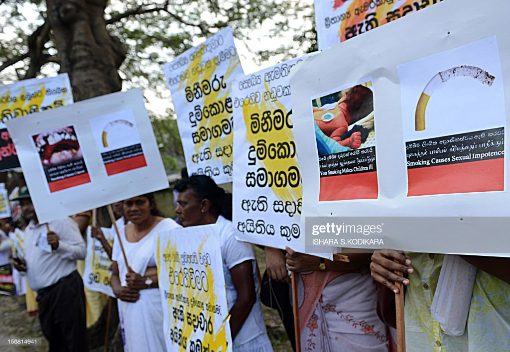 Sri Lanka's anti-smoking activists demonstrate outside the country's Supreme Court demanding tougher measures to discourage cigarettes in Colombo on November 20, 2012. A tobacco company has petitioned court against proposed legislation that makes it compulsuory to have pictorial depictions of the harmful effects of smoking on every packet of cigarettes. AFP PHOTO/Ishara S. KODIKARA