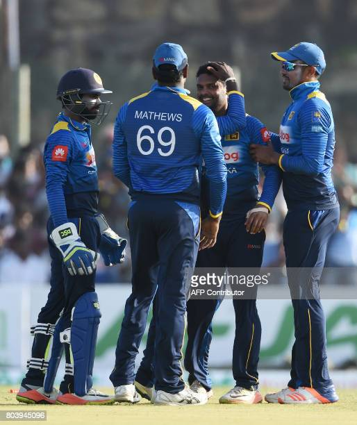 Sri Lanka's Asela Gunaratne celebrates with his teammates after he dismissed Zimbabwe's Solomon Mire during the first oneday international cricket...