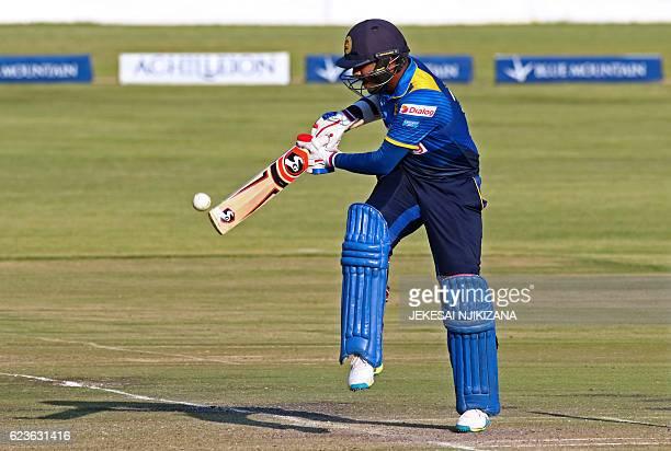 Sri Lanka's batsman Shehan Jayasuriya plays a shot during the second One Day International cricket match between Sri Lanka and West Indies at Harare...