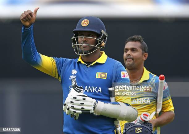 Sri Lankas captain Angelo Mathews and Sri Lankas Asela Gunaratne celebrate victory at the end of the ICC Champions Trophy match between India and Sri...