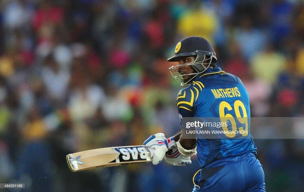 Sri Lanka's captain Angelo Mathews plays a shot during the second One Day International (ODI) match between Sri Lanka and Pakistan at the Suriyawewa Mahinda Rajapakse International Cricket Stadium in the southern district of Hambantota on August 26, 2014.