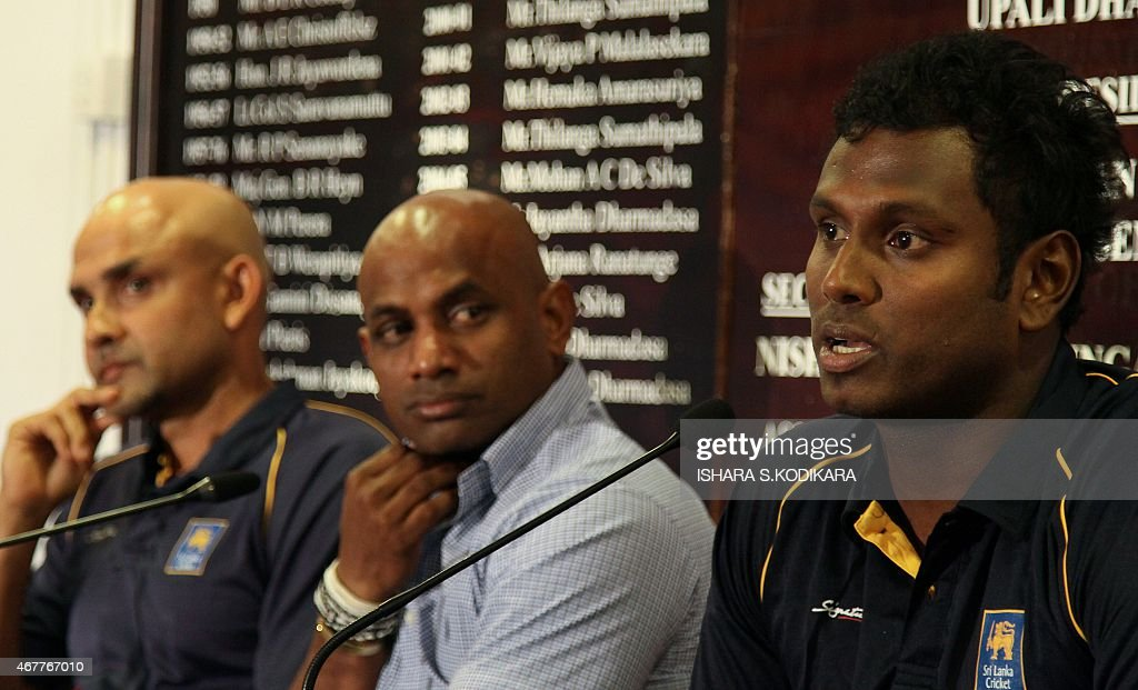Sri Lanka's captain Angelo Mathews speaks as cricket coach Marvan Atapattu and chief cricket selector Sanath Jayasuriya look on during a press...