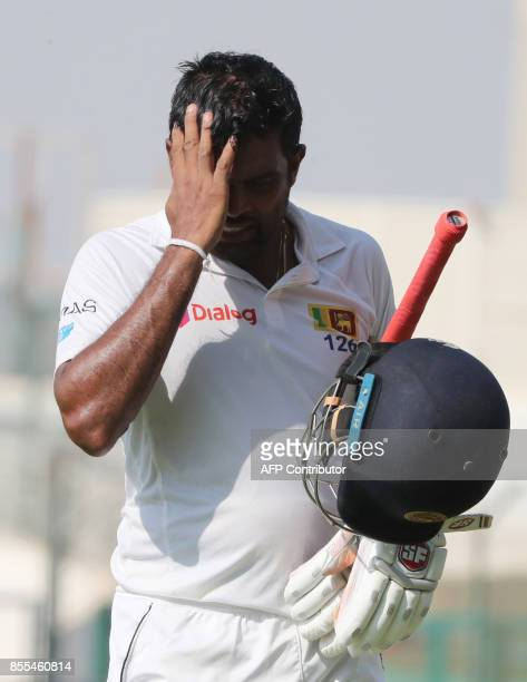 Sri Lanka's captain Dilruwan Perera leaves the field during the second day of the first Test cricket match against Pakistan at Sheikh Zayed Stadium...