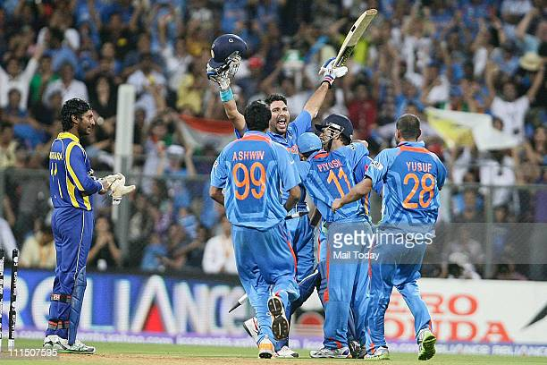 Sri Lanka's captain Kumar Sangakkara left looks on as India's captain Mahendra Singh Dhoni center back and Yuvraj Singh greeted by Ravichandran...
