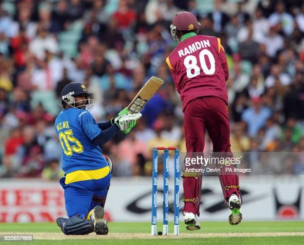 Sri Lanka's Chamara Silva is caught behind by Denesh Ramdin during the ICC World Twenty20 Semi Final at The Oval London