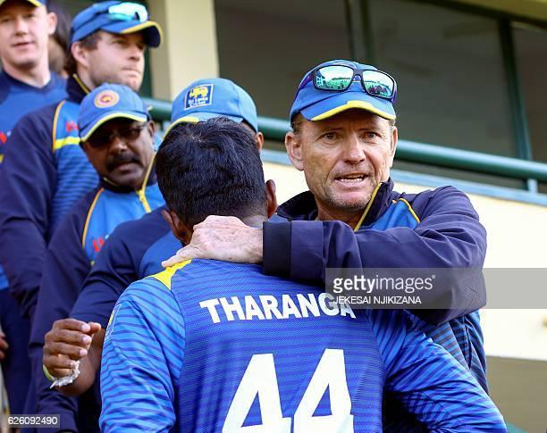 Sri Lanka's coach Graham Ford congratulates captain Upul Tharanga after their team won the final of the Blue Mountain Achilleion triseries played...