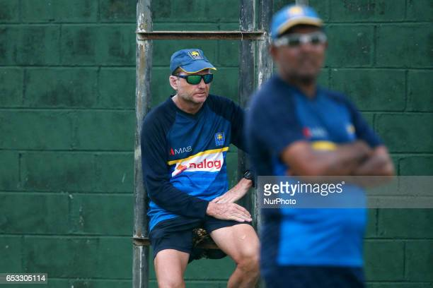 Sri Lanka's cricket team coach Graham Ford and Asanka Gurusinha watch their team members during a practice session prior to their test cricket match...