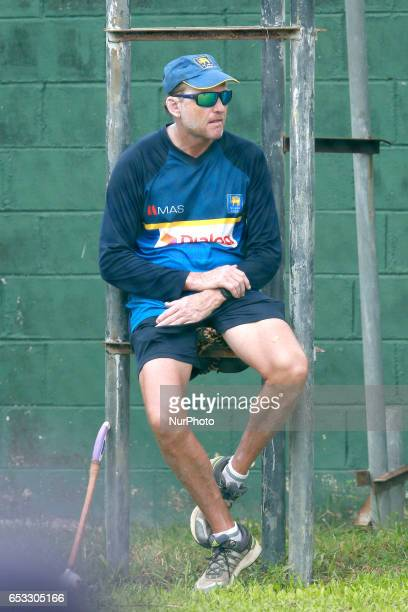Sri Lanka's cricket team coach Graham Ford watch his team members during a practice session prior to their test cricket match against Bangladesh in...