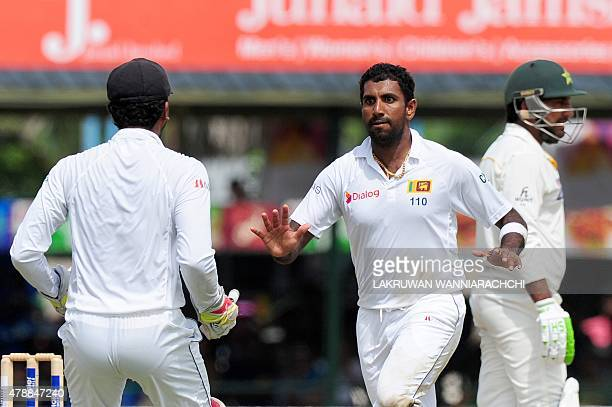 Sri Lanka's cricketer Dhammika Prasad celebrates with wicketkeeper Dinesh Chandimal the wicket of Pakistan cricketer Sarfraz Ahmed during the fourth...