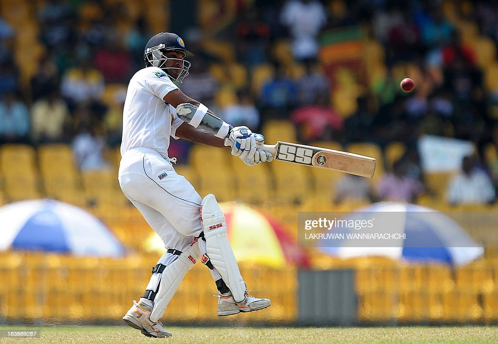 Sri Lanka's cricketer Kumar Sangakkara plays a shot during the second day of their second Test match between Sri Lanka and Bangladesh at the R. Premadasa Cricket Stadium in Colombo on March 17, 2013.