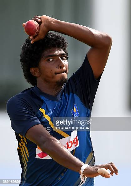 Sri Lanka's cricketer Lakshan Sandakan delivers a ball during a practice session at The Galle International Cricket Stadium in Galle on August 3 2016...
