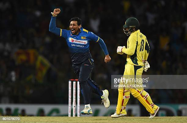 Sri Lanka's cricketer Tillakaratne Dilshan celebrates after the dismissal of Australia's Matthew Wade during the final T20 international cricket...