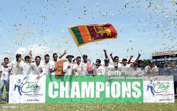 Sri Lanka's cricketers pose for photographers after victory in the third and final Test match between Sri Lanka and Australia at The Sinhalese Sports...