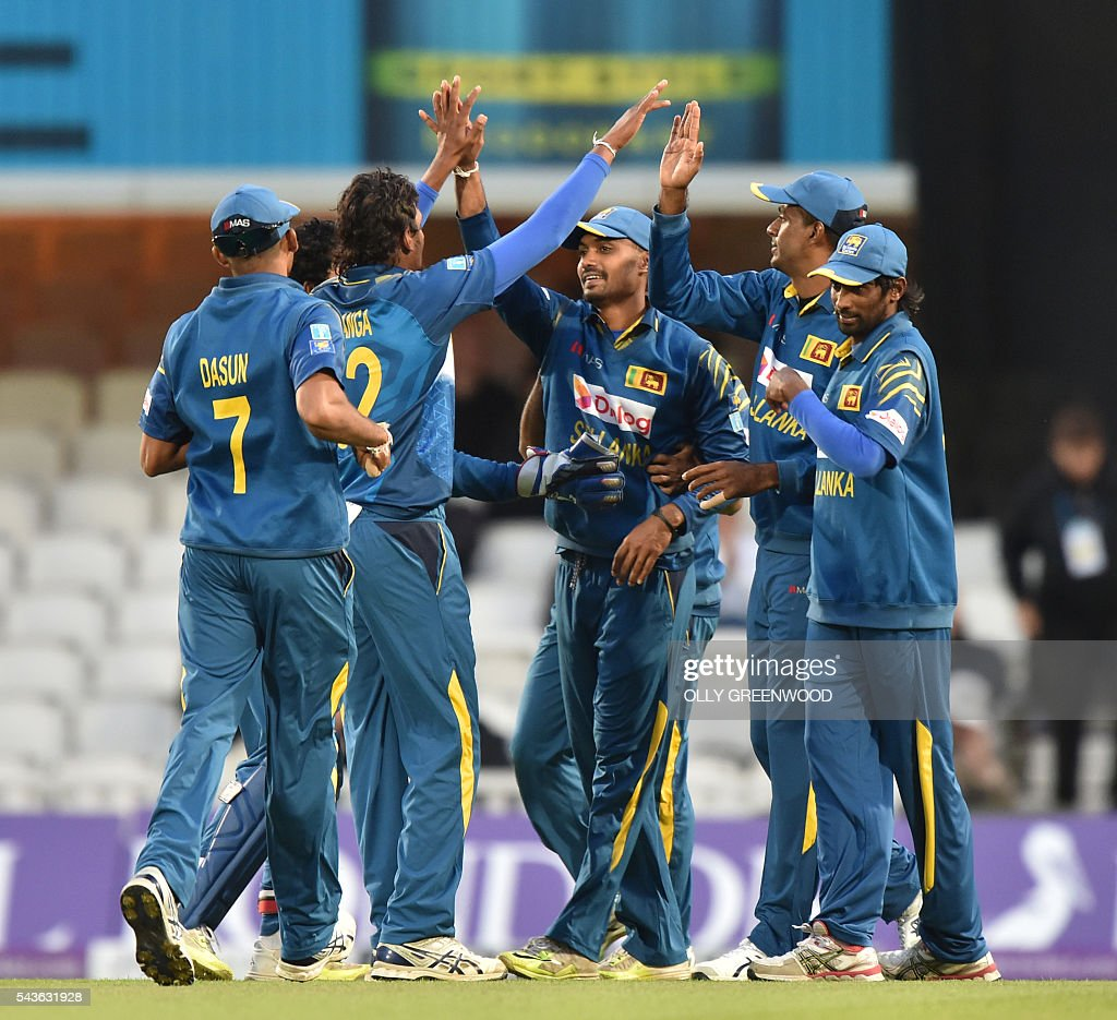 Sri Lanka's Danushka Gunathilaka (C) celebrates with his teammates after catching England's Eoin Morgan during play in the fourth One Day International (ODI) cricket match between England and Sri Lanka at The Oval cricket ground in London on June 29, 2016. England's victory target was revised to 308 off 42 overs due to the weather having seen the tourists show real guile and style in their innings. / AFP / OLLY