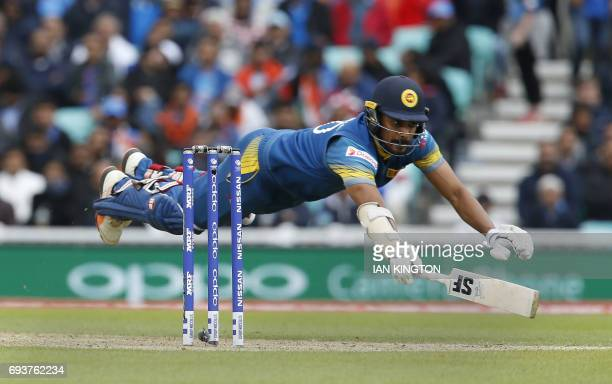 Sri Lankas Danushka Gunathilaka dives to avoid a run out during the ICC Champions Trophy match between India and Sri Lanka at The Oval in London on...