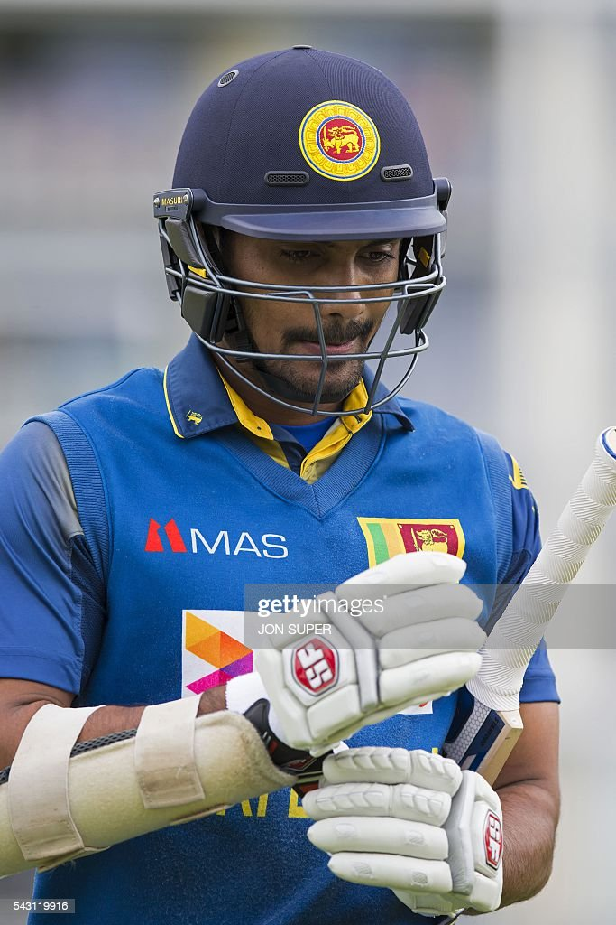 Sri Lanka's Danushka Gunathilaka leaves the field after losing his wicket for one run off the bowling of England's David Willey, during play in the third one day international (ODI) cricket match between England and Sri Lanka at Bristol cricket ground in Bristol, south-west England, on June 26, 2016. / AFP / JON