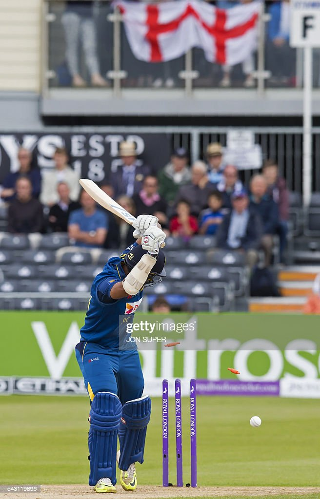 Sri Lanka's Danushka Gunathilaka looks to the stumps as he loses his wicket for one run off the bowling of England's David Willey, during play in the third one day international (ODI) cricket match between England and Sri Lanka at Bristol cricket ground in Bristol, south-west England, on June 26, 2016. / AFP / JON
