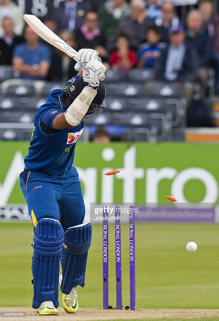 Sri Lanka's Danushka Gunathilaka watches the bails fly as he loses his wicket for one run off the bowling of England's David Willey, during play in the third one day international (ODI) cricket match between England and Sri Lanka at Bristol cricket ground in Bristol, south-west England, on June 26, 2016. / AFP / JON