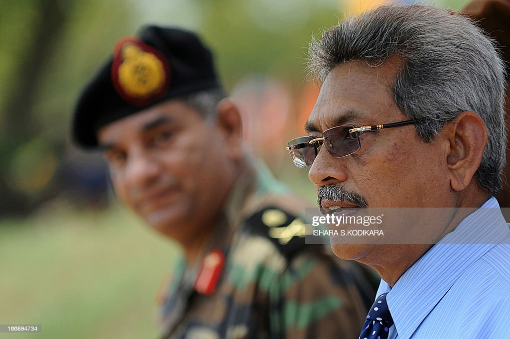 Sri Lanka's Defence secretary Gotabhaya Rajapakse (R) and Army Chief Jagath Jayasuriya (L) look on during a ceremony in the eastern region of Thoppigala on April 18, 2013. The monument commemorated government troops killed while wresting control over the region from Tamil Tiger rebels during the war. AFP PHOTO/ Ishara S. KODIKARA