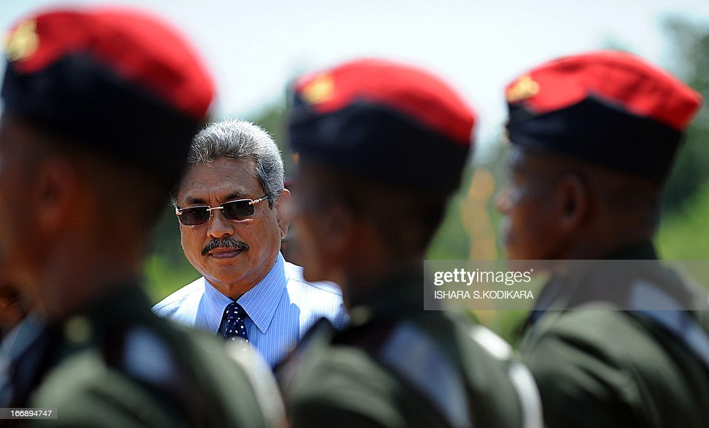 Sri Lanka's Defence secretary Gotabhaya Rajapakse (2L) inspects a guard of honour during a ceremony commemorating fallen soldiers in the eastern region of Thoppigala on April 18, 2013. The monument commemorated government troops killed while wresting control over the region from Tamil Tiger rebels during the war. AFP PHOTO/ Ishara S. KODIKARA