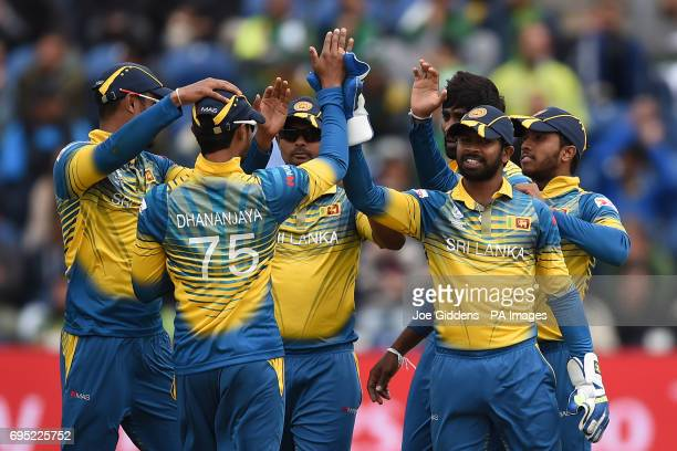 Sri Lanka's Dhananjaya de Silva and Niroshan Dickwella celebrate taking the wicket of Pakistan's Babar Azam during the ICC Champions Trophy Group B...