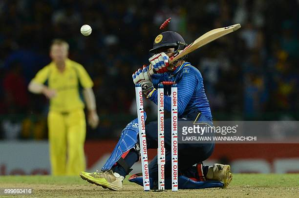 Sri Lanka's Dhananjaya de Silva gets dismissed by Australia's James Faulkner during the first T20 international cricket match between Sri Lanka and...