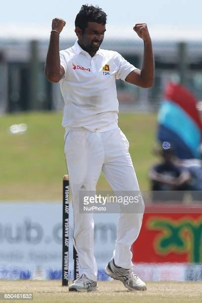 Sri Lanka's Dilruwan Perera celebrates after he dismissed Bangladesh batsman Mehedi Hasan during the third day of the opening Test cricket match...