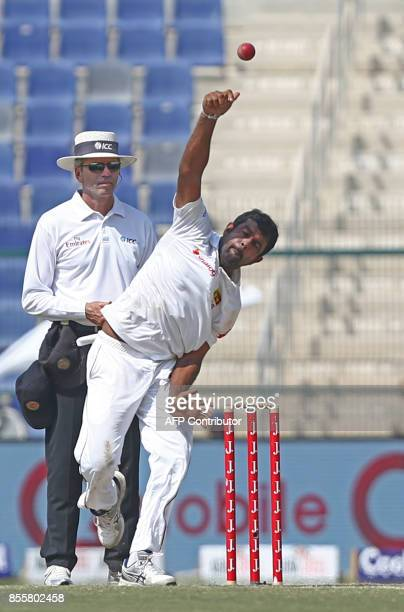 Sri Lanka's Dilruwan Perera delivers the ball during the third day of the first Test cricket match between Sri Lanka and Pakistan at Sheikh Zayed...